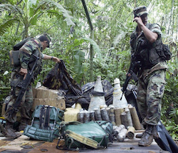 Ecuadoran security forces inspect a suspected FARC encampment