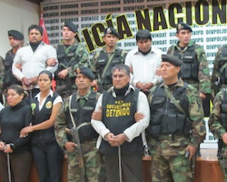 Suspected members of the Gran Familia following their arrest