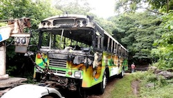 A bus burned by alleged gang members in El Salvador