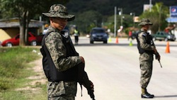 Soldiers at a security checkpoint in San Salvador