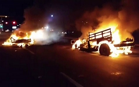 Burning vehicles following the ambush of Mexican military in Culiacán on September 30.