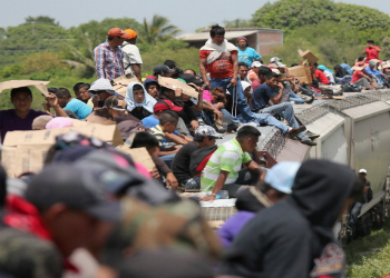 US-bound migrants riding on a Mexican freight train