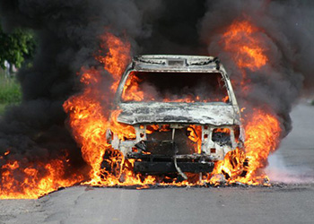 A police vehicle set on fire by prisoners