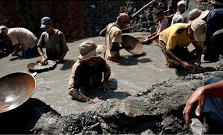 Miners pan for gold at an illicit pit in Antioquia, Colombia