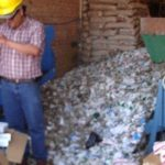 Workers began destroying the more than 70 tons of contraband cigarettes in Santa Cruz