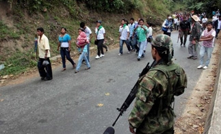 A FARC guerrilla mans a checkpoint in the southwestern department of Cauca