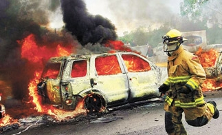 Jalisco Cartel blockade street with burning car