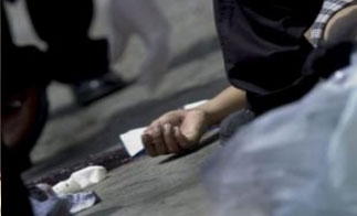 Police examine a crime scene in San Salvador