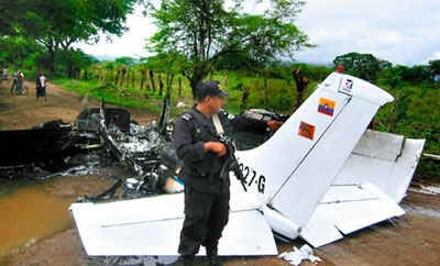 Honduran police with a destroyed narco-plane