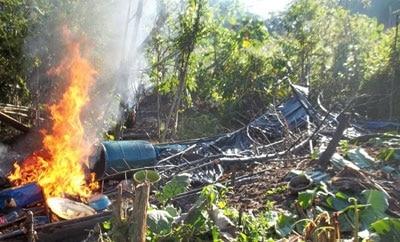 A coca processing laboratory burned in Loreto, Peru