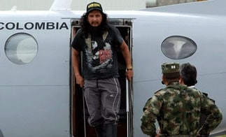 ELN kidnapping victim Orlando Ibarra Sarmiento steps off a plane in Bogota