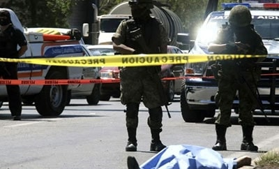Mexican authorities investigate a homicide scene