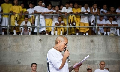 An imprisoned Barrio 18 leader reads a joint statement issued by the gangs