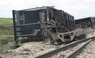 Aftermath of previous FARC attack on coal railroad