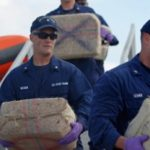Coast Guard officials in Florida unload seized cocaine in March 2012