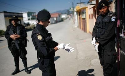 Guatemalan police officers conducting a search in Alta Verapaz
