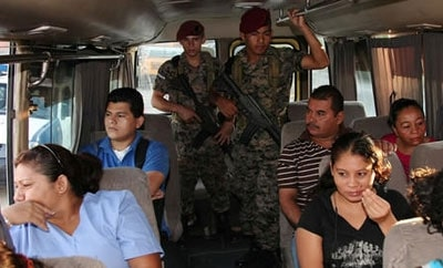 Honduran soldiers on a public  bus in San Pedro Sula