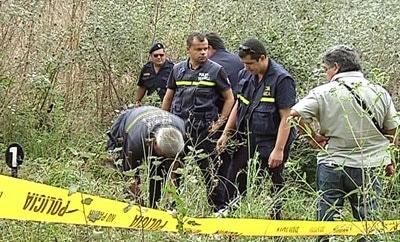Uruguayan police examine a homicide scene