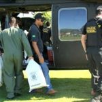 Brazilian officials unload a seized drug plane from Bolivia