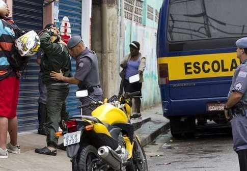 Police search residents in Paraisopolis favela, Sao Paulo