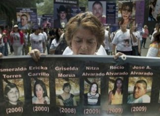 A woman protesting disappearances in Mexico City, 2012
