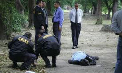 Police inspect a crime scene in Caracas