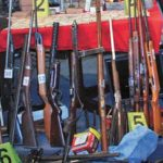 Seized weapons outside Bolivia's Ministry of Government