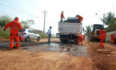 Inmates at a semi-open prison in Brazil work on roads