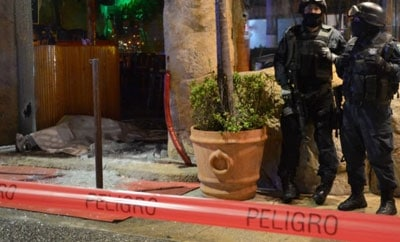 Police stand guard following attack in Torreon bar