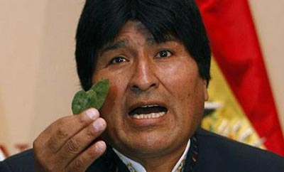 Bolivian President Evo Morales, with coca leaf