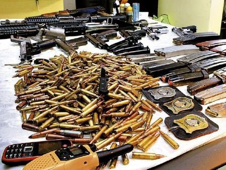 Trove of weapons and police IDs seized