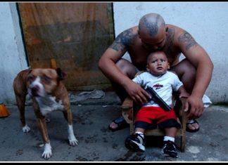 Guatemalan Mara plays with his son