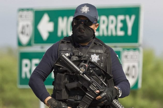 A heavily armed Mexican policeman