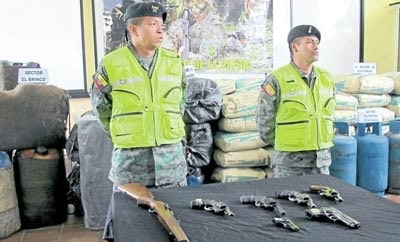Ecuadorian soldiers present the seized cement