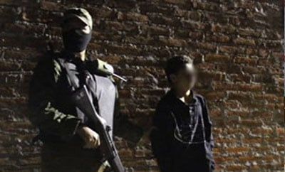 A child assassin arrested in Mexico in 2012