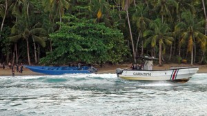 Costan Rican authorities tow the seized boat