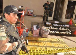 Anti-narcotics police guarding a drug seizure
