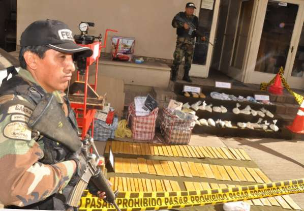 Anti-narcotics police guarding a drug seizure
