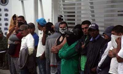 Members of a self-defense group arrested by Mexican authorities in Michoacan