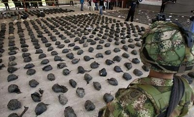 A soldier guards cocaine seized in southwest Colombia