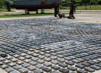 Authorities display a large cocaine seizure