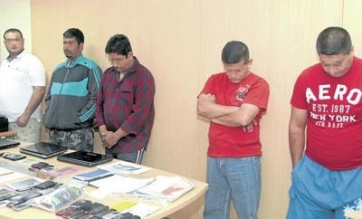 Suspects in an India-Ecuador human trafficking ring