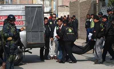Peru police remove the bodies of dead fugitives