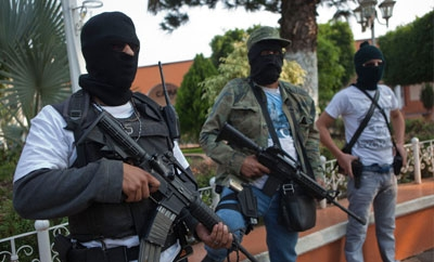 Vigilantes stand guard in Coalcoman, Mexico