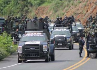 Police, soldiers sent to remove roadblocks in Michoacan