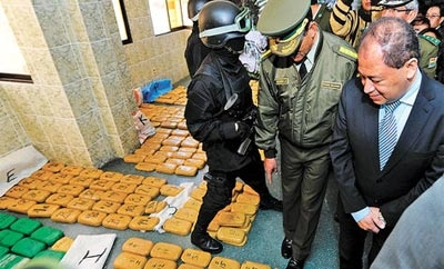 Bolivian authorities inspect seized cocaine