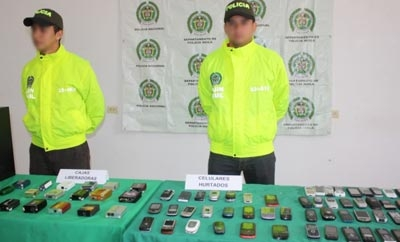 Colombian police with stolen cell phones