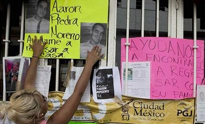 Posters of the 12 people who disappeared from a Mexico City bar