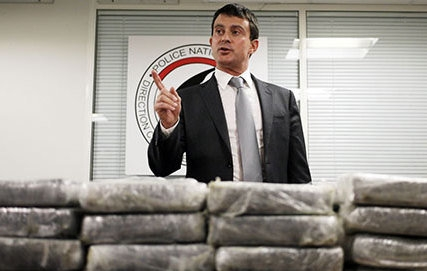 French Interior Minister Manuel Valls with part of the haul