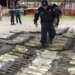 El Salvador police inspect the recovered grenades